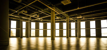 Commercial premises in a shopping center rental. In gold color  with ventilation system Royalty Free Stock Image