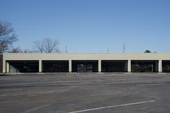 Commerial Retail Space for Rent, Purchase or Lease. A commercial property in a strip mall for purchase, lease, or rent that can be used for a restaurant royalty free stock photography