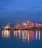 Commercial sea port at dusk Stock Photo