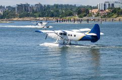 Commercial Seaplane preparing for Take off. Passenger Seaplane Preparing for Take off. Another Seplane that has just Landed is Visible in Background. Victoria stock photography