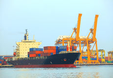 Commercial ship and cargo container on port use for import expor Royalty Free Stock Images