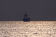 Commercial ship at dusk Royalty Free Stock Image