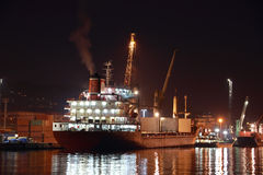 Commercial ship in harbor at night Stock Photo