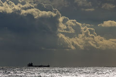 Commercial ship on the horizon Royalty Free Stock Image
