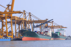 Commercial ship loading container in shipping port image use for Stock Photography