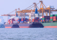 Commercial ship loading container in shipping port image use for Royalty Free Stock Photos