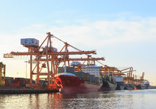Commercial ship loading container in shipping port image use for. Import ,export nautical vessel transport and industry logistic royalty free stock photos
