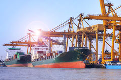 Commercial ship loading container in shipping port image use for. Import ,export nautical vessel transport and industry logistic stock photos