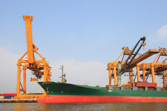 Commercial ship on port  with big loading crane Royalty Free Stock Photos