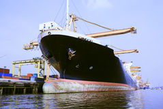 Commercial ship in port loading container Stock Photo