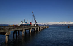 Commercial shipping pier on a sunny day Stock Images