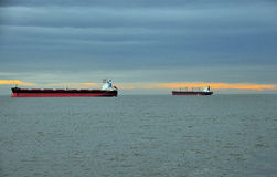 Commercial ships delivering cargo, roaring25 Stock Photography