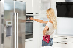 Commercial shot blond girl cooking Royalty Free Stock Photography