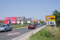 Commercial signs by the road in Romania Royalty Free Stock Photos