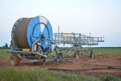 Commercial sprinkler. A farmland commercial hose and sprinkler Stock Images