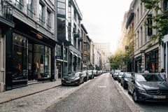 Commercial street in Antwerp at sunset with sunlight on backgrou Stock Image