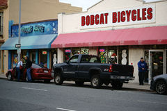 Commercial Street Salinas. Salinas, United States - December 22, 2015: Cars parked in the Monterey commercial street in front of the bike shop Bobcat Bicycles royalty free stock photo
