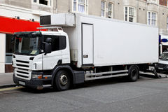 Commercial truck. White commercial delivery truck parked on street Royalty Free Stock Photos