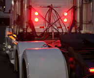 COMMERCIAL TRUCK W/ CUSTOM FENDERS AND LIGHTS. The back of a commercial truck at dusk with custom fenders and lights Stock Photography