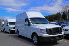 White Commercial Vans. New white commercial van parked in row royalty free stock photos