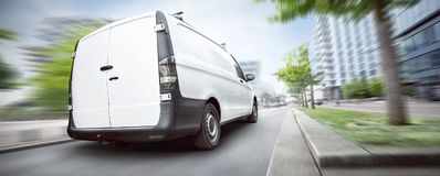 Commercial van driving in the city Panorama royalty free stock photos