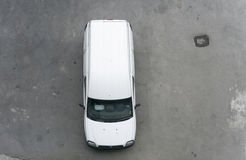 Commercial vehicle. White small commercial cargo vehicle parked on grey concrete stock photos