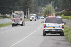 Commercial Vehicle Safety Enforcement. A CVSE vehicle parked on the side of the road observes commercial vehicles for infractions Royalty Free Stock Photo
