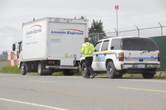 Commercial Vehicle Safety Enforcement. A CVSE police officer stops a vehicle that he intends to inspect Stock Photo