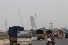 Commercial vehicles on outer ring road, Delhi, India. Commercial vehicles moving along with passenger vehicles on outer ring road, Delhi, India. Under royalty free stock images
