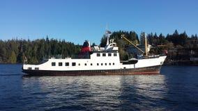 Commercial vessel entering Bamfield. Vessel entering Bamfield stock photos