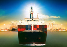 Commercial vessel ship and port container dock behind use for fr. Eight water transport and logistic shipping business theme Royalty Free Stock Photo