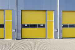 Commercial warehouse. Exterior of a commercial warehouse with yellow roller doors Stock Image