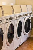 Commercial Washing machines. Row of washing machines in laundromat Royalty Free Stock Images