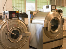 Commercial Washing Machines. A couple of very heavy duty commercial washing machines stock image
