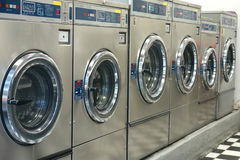 Commercial Washing Machines. At a laundromat royalty free stock photography