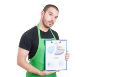 Commercializzi la lavagna per appunti della tenuta del venditore con il profitto e la previsione Fotografia Stock