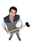 Commerciante che tiene un maglio Fotografia Stock Libera da Diritti
