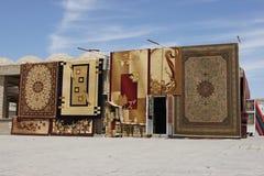 Commerciante della moquette, strada di seta, Buchara, Uzbekistan Immagini Stock