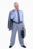 Commerciante maturo che si leva in piedi con la valigia ed il rivestimento Immagini Stock
