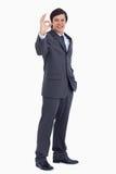 Commerciante sorridente che dà la sua approvazione Immagine Stock