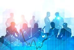 Commercieel team bij bureaulijst, grafieken royalty-vrije stock afbeelding