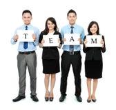 Commercieel team dat klein leeg document houdt Royalty-vrije Stock Afbeelding