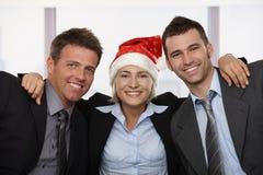 Commercieel team in de hoed van de Kerstman Stock Afbeeldingen