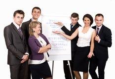 Commercieel team dichtbij tikgrafiek stock afbeeldingen