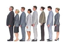 Commercieel team die zich in rij bevinden Stock Afbeelding