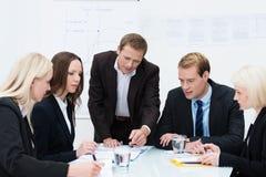 Commercieel team in een vergadering Stock Fotografie