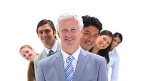 Commercieel team in lijn achter hun werkgever Stock Afbeeldingen