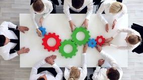 Commercieel team met radertjes stock video