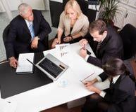 Commercieel team op de vergadering Stock Afbeelding
