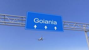 Commercieel vliegtuig die aan de luchthaven van Goiania aankomen Het reizen naar het conceptuele 3D teruggeven van Brazilië Stock Afbeeldingen